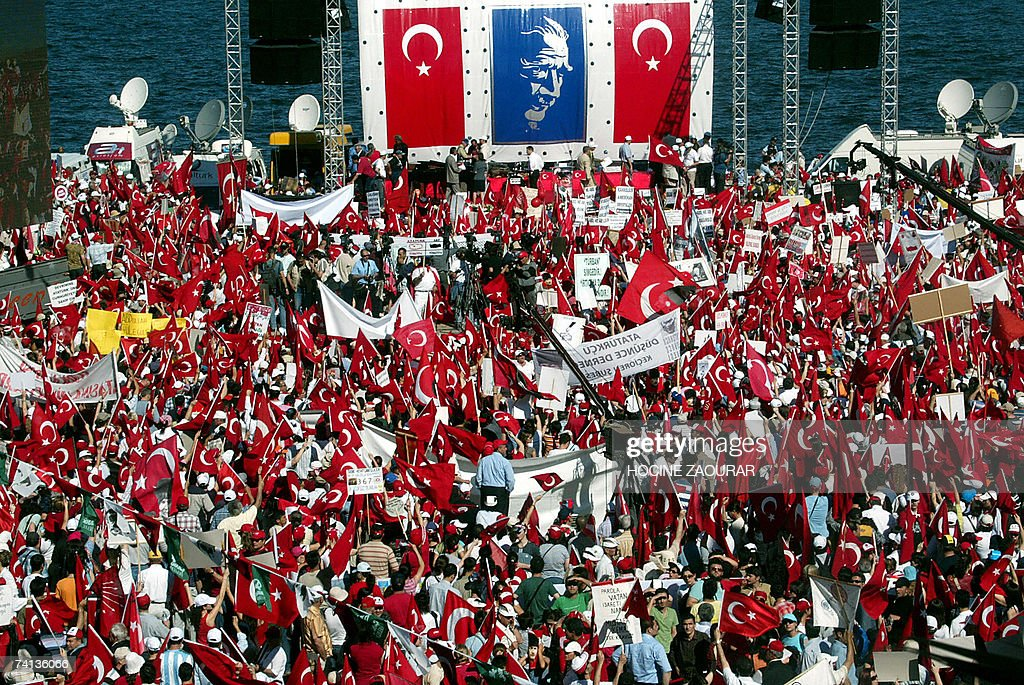 Turkish protesters hold up their national flags during a massive secular rally in the western Turkish city of Izmir 13 May 2007. A bomb ripped through a marketplace in Izmir the previous day on the eve of the rally, killing one person and leaving 14 others injured, officials said.