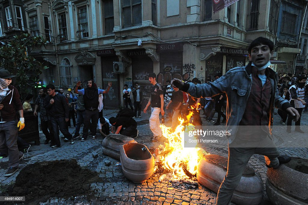 Turkish protesters set a fire as they battle police to mark the one-year anniversary of the Gezi Park protests on May 31, 2014 in Istanbul, Turkey. The original protest over the removal of trees to convert a downtown park into a shopping mall turned into a broader, month-long protest against the authoritarian rule of Turkish Prime Minister Recep Tayyip Erdogan, presenting the political biggest challenge to the PM and his ruling AK Party (AKP) after more than a decade in power.
