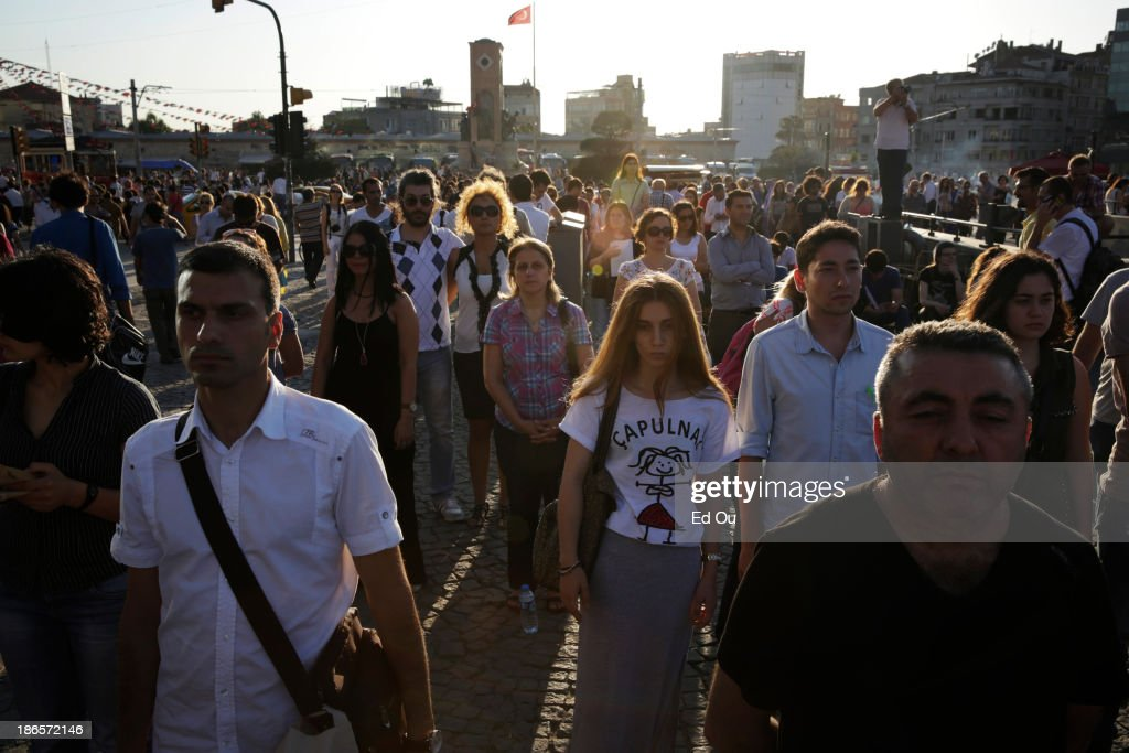 Turkish protesters stand silently as an act of defiance against the government's evacuation of Gezi Park and Taksim Square which happened late last...
