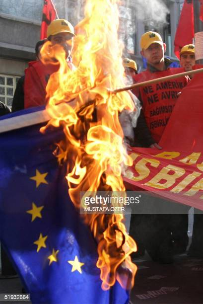 Turkish protestors burns EU flag during the demonstration in front of an EU office in Istanbul 10 January 2005 organized by the Turkish Youth...
