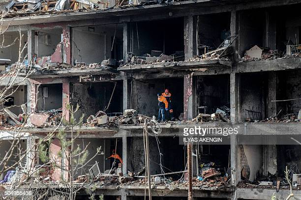 TOPSHOT Turkish recue search through the wreckage of a blast damaged building on January 14 2016 in Diyarbakir Six people died and 39 others were...