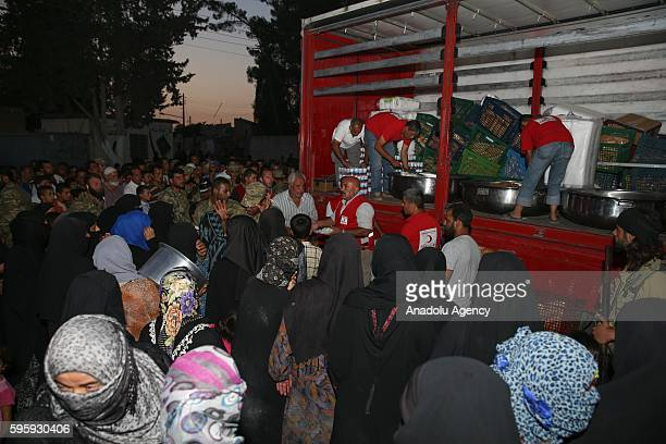 Turkish Red Crescent members distribute hot food to the residents in Jarabulus District of Aleppo Syria after taking control of the district's...