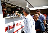 Turkish Red Crescent vehicle offers foods and vehicles to relatives of wounded citizens at outside the Ankara Numune Hospital after 'Parallel...