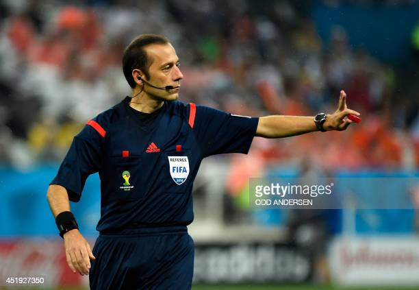 Turkish referee Cuneyt Cakir gestures during the semifinal football match between Netherlands and Argentina of the FIFA World Cup at The Corinthians...