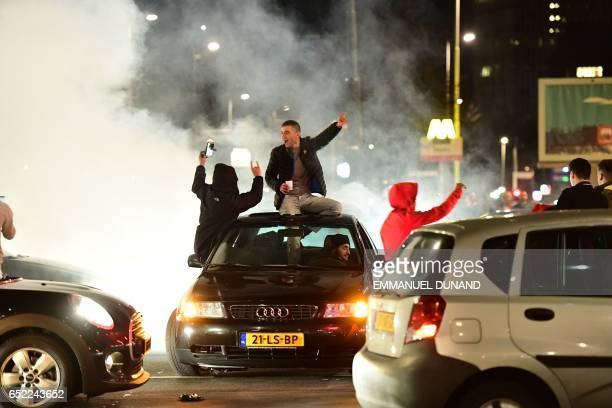 Turkish residents of the Netherlands gather for a protest in Rotterdam on March 11 2017 Protests erupted in the Dutch port city of Rotterdam late on...