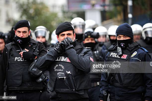 Turkish riot police block the street while Supporters of the leftwing Freedom and Solidarity Party shout slogans in solidarity of Greece's ruling...