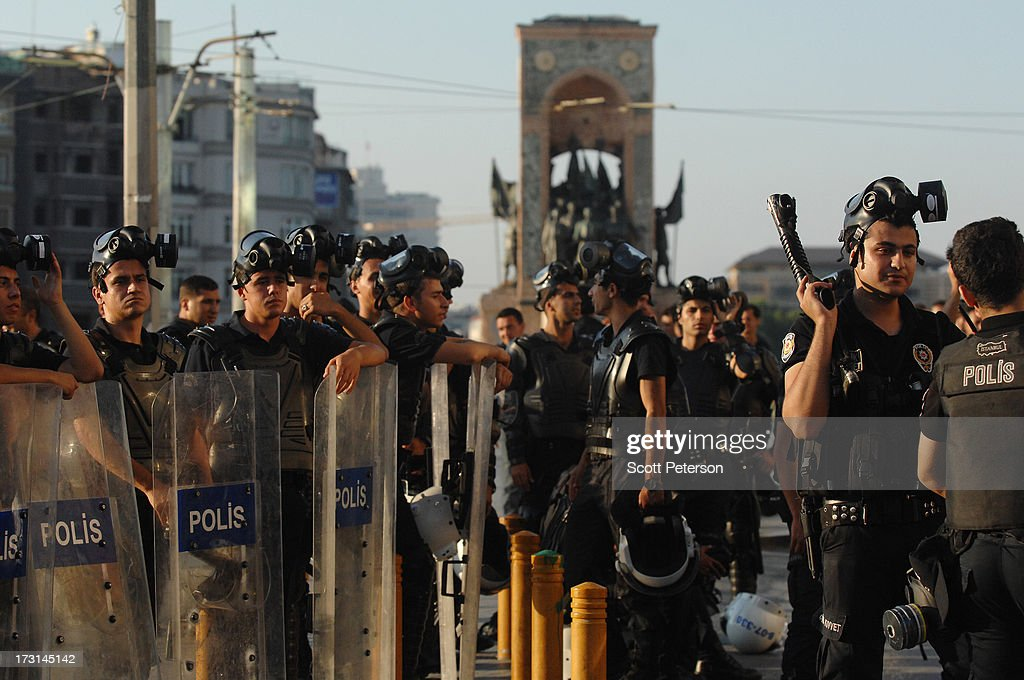 Turkish riot police line up in front of a statue dedicated to the founder of modern Turkey, Mustafa Kemal Ataturk, in Taksim Square on July 8, 2013 in Istanbul, Turkey. The protests began in late May over the Gezi Park redevelopment project and saving the park trees adjacent to Taksim Square but swiftly turned into a protest aimed at Prime Minister Recep Tayyip Erdogan and what protestors call his increasingly authoritarian rule. The protest spread to dozens of cities in Turkey, in secular anger against Mr. Erdogan and his Islam-rooted Justice and Development Party (AKP).
