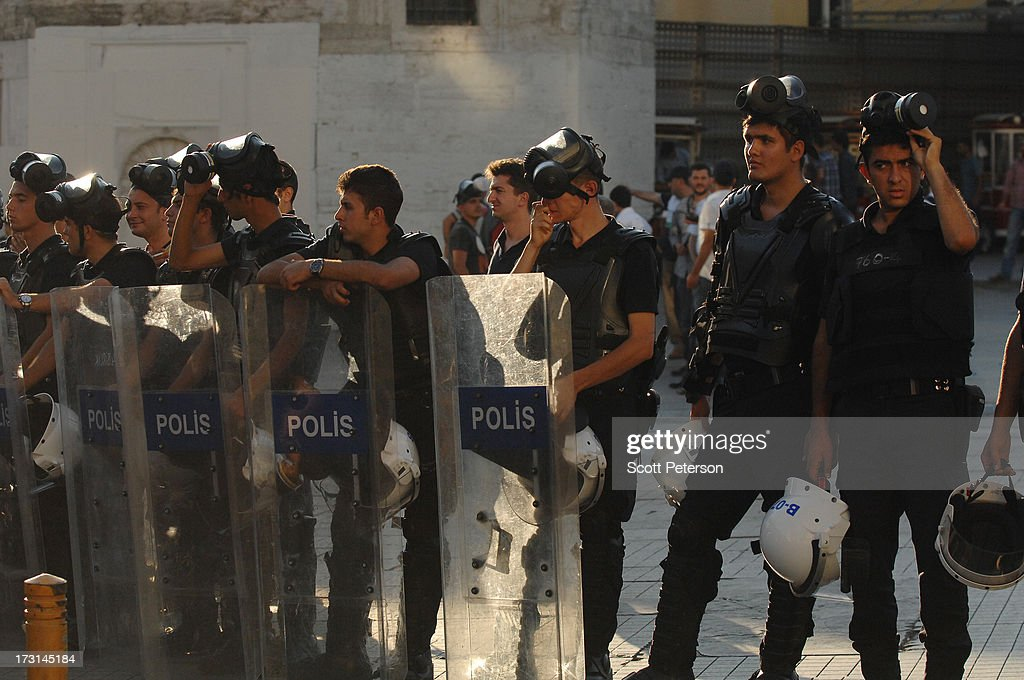 Turkish riot police prepare for street clashes with anti-government protestors in Taksim Square on July 8, 2013 in Istanbul, Turkey. The protests began in late May over the Gezi Park redevelopment project and saving the park trees adjacent to Taksim Square but swiftly turned into a protest aimed at Prime Minister Recep Tayyip Erdogan and what protestors call his increasingly authoritarian rule. The protest spread to dozens of cities in Turkey, in secular anger against Mr. Erdogan and his Islam-rooted Justice and Development Party (AKP).