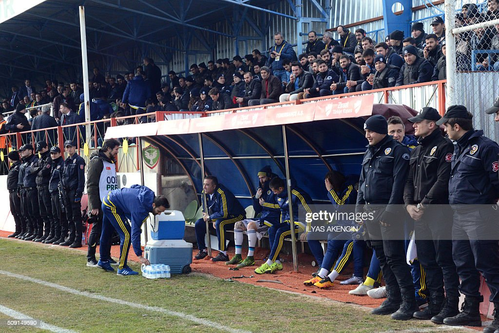 Turkish riot police stand guard next to Fenerbahce's players on February 9, 2016 in Diyarbakir during the Turkish Cup football match between Amed Spor and Fenerbahce Zirrat on February 9, 2016 in Diyarbakir. The Turkish Football Federation said on February 5, 2016 it had suspended a Kurdish player for statements considered 'ideological propaganda' on the conflict in the Kurdish-majority southeast, adding to a string of cases cracking down on freedom of expression in Turkey. AKENGIN