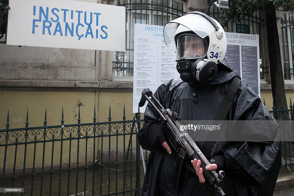 A Turkish riot police stands guard in front of French Consulate during a rally in Istanbul on January 11, 2013. Demonstrators gathered at the French Consulate in Istanbul following the killings of three Kurdish women activists on 10 January, including Sakine Cansiz, a founding member of the militant Kurdistan Workers Party (PKK). Cansiz, who had been living in exile in France for years, was found dead in the early hours of 10 January in a Kurdish documentation centre on the first floor of an apartment building near Gare du Nord train station. Two other women - the president of the centre, Fidan Dogan, and Leyla Soylemez, also described as an activist - were also killed.