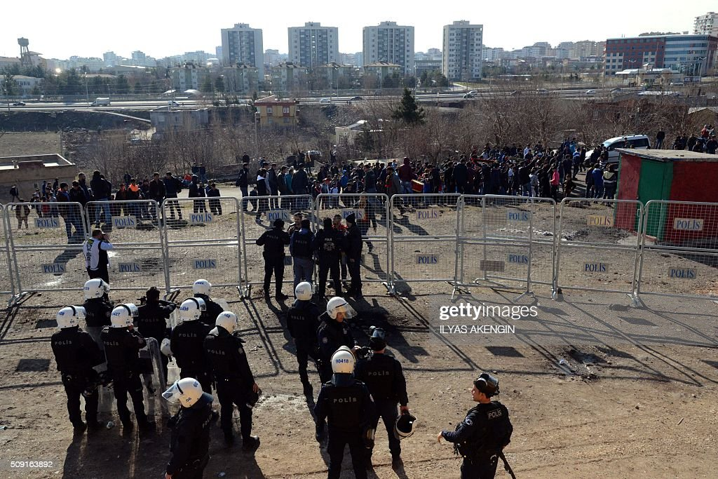 Turkish riot police try to disperse fans arround the stadium on February 9, 2016 in Diyarbakir, southeastern Turkey, during the Ziraat Turkish Cup football match between Amedspor and Fenerbahce. The Turkish Football Federation said on February 5 it had suspended a Kurdish player for statements considered 'ideological propaganda' on the conflict in the Kurdish-majority southeast, adding to a string of cases cracking down on freedom of expression in Turkey. / AFP / ILYAS AKENGIN