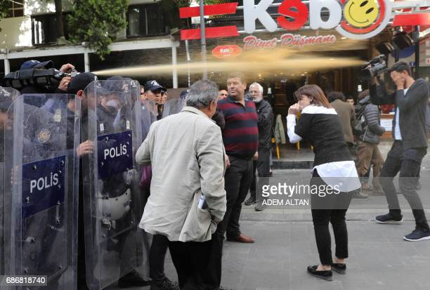 TOPSHOT Turkish riot police use tear gas to disperse protesters during a demonstration against the arrest of hunger strikers Nuriye Gulmen and Semih...