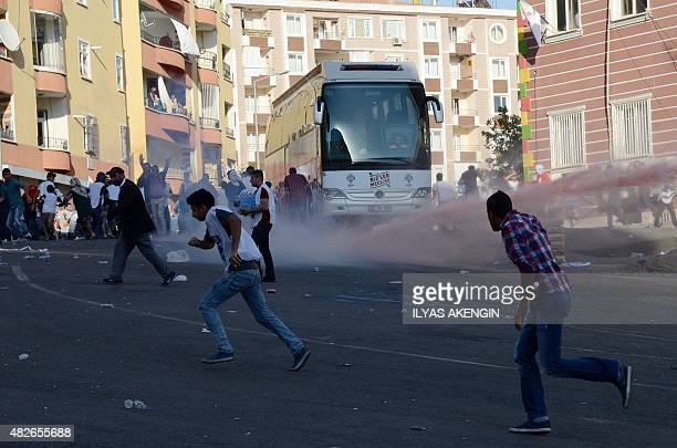 Turkish riot police use water cannon to disperse protesters in Diyarbakir on August 1 2015 during a demostration against jailed Kurdish leader...