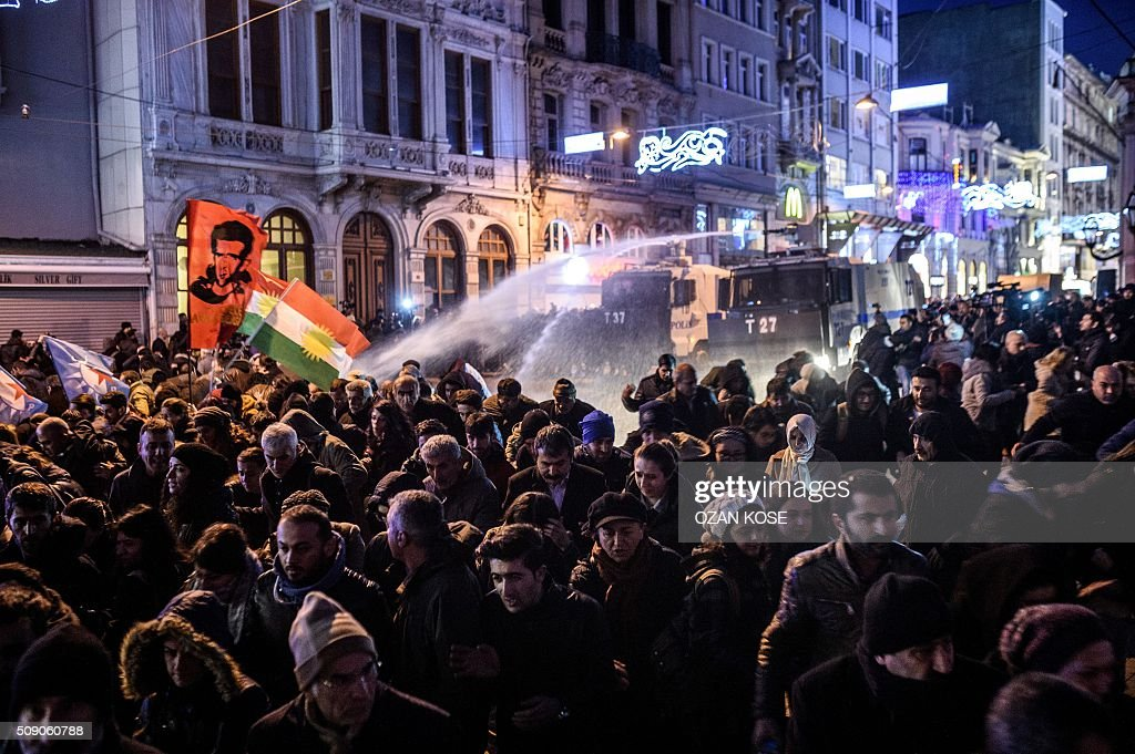 TOPSHOT Turkish riot police use water cannon to disperse protesters on Istiklal avenue in Istanbul on February 8 2016 during a demonstration against...
