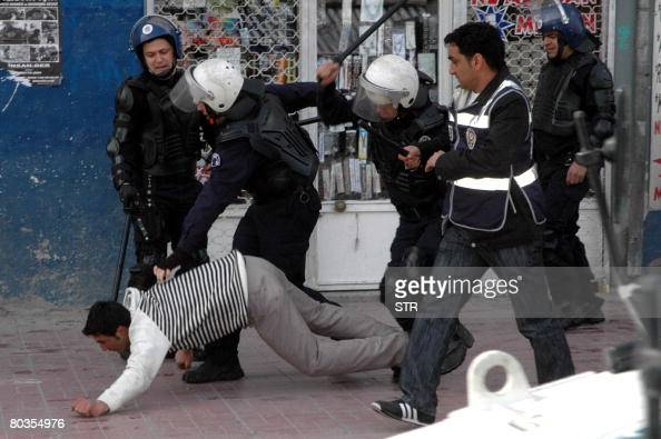 Turkish riot policemen beat a protester during a clash in Van on March 24 2008 Unrest in the Kurdish region of southeast Turkey on Sunday left two...