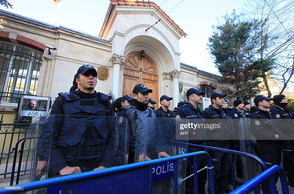 Turkish riot policemen stand guard during a demonsration to denounce French intervention in Mali in front of the French Consulate on January 16, 2013, in Istanbul. French troops engaged in close-quarter combat with Islamist fighters in the Malian town of Diabaly in their first ground clashes after days of air strikes, security sources said.