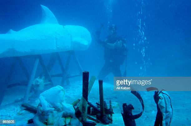 Turkish sculptor Kemal Tufan works on his art the world's first underwater sculpture September 22 2000 near the southern town of Kas Turkey Tufan...
