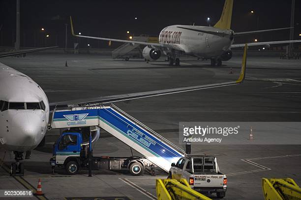 Turkish security forces and firefighters take security measures after an explosion at Sabiha Gokcen Airport in Istanbul Turkey on December 23 2015...