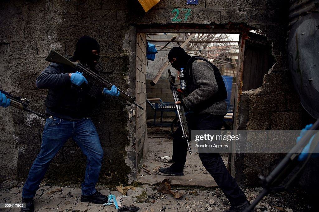 Turkish security forces inspects and search a building where PKK heavily damaged whole neighborhood during a counter terrorism operation against...