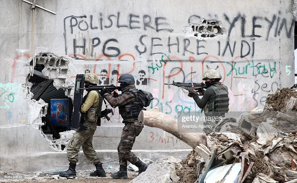 Turkish security forces patrol on a street where PKK heavily damaged whole neighborhood during a counter terrorism operation against terrorist...