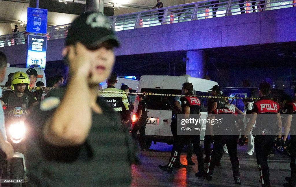 Turkish security officers gather outside Turkey's largest airport, Istanbul Ataturk, on June 28, 2016 in Istanbul, Turkey. Three suicide bombers opened fire before blowing themselves up at the entrance to the main international airport in Istanbul, killing at least 28 people and wounding at least 60 people, according to Istanbul governor Vasip Sahin.