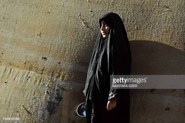 A Turkish Shiite girl looks on as she takes part in a religious procession held for Ashura in Istanbul on December 5 2011 Ashura commemorates the...