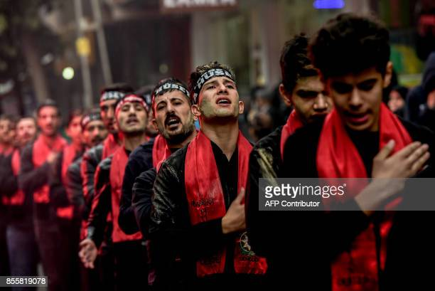Turkish Shiite men take part in a religious procession held for the Shiite religious holiday of Ashura on September 30 in Istanbul Ashura...