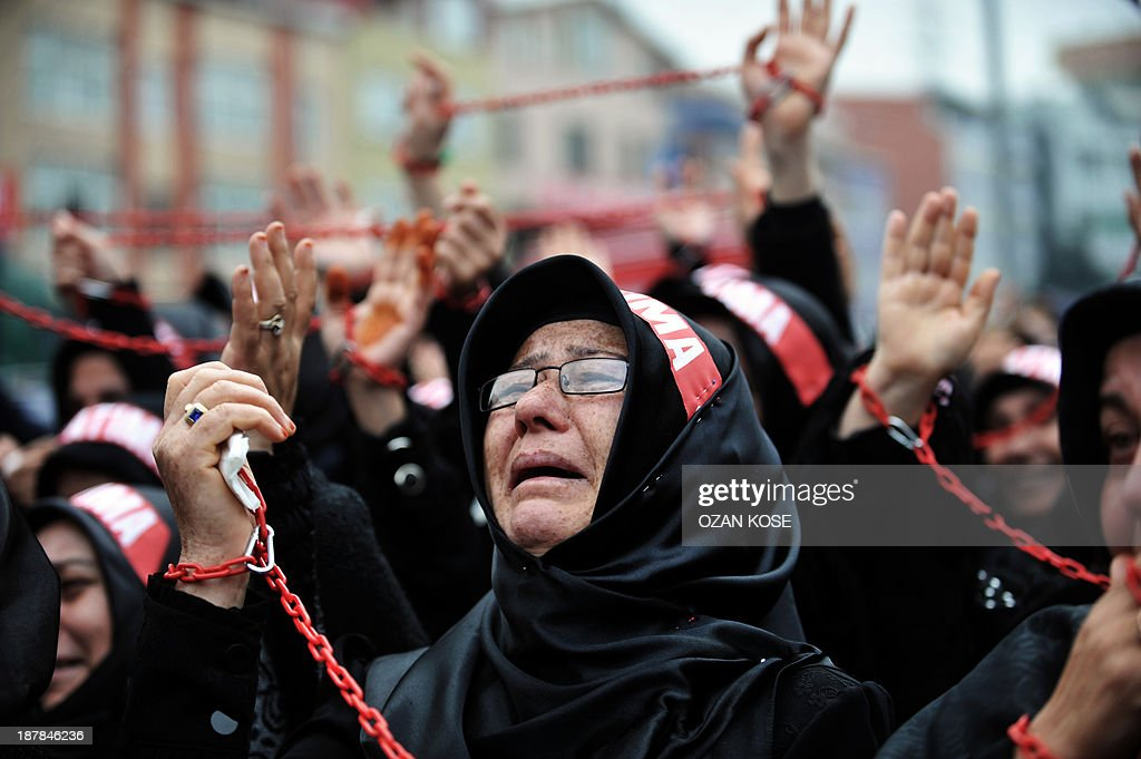 A Turkish Shiite woman cries and holds up a chain as she takes part in a religious procession held for the Shiite religious holiday of Ashura on November 13, 2013, in Istanbul. Ashura commemorates the killing of Imam Hussein, a grandson of the Prophet Mohammed, by armies of the caliph Yazid in 680 AD. Tradition holds that the revered imam was decapitated and his body mutilated in the Battle of Karbala. AFP PHOTO / OZAN KOSE