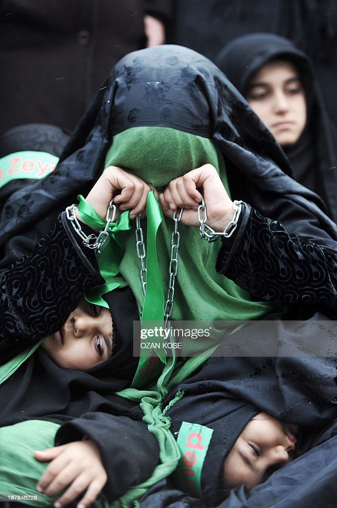 A Turkish Shiite woman holds chains as she takes part in a religious procession held for the Shiite religious holiday of Ashura on November 13, 2013, in Istanbul. Ashura commemorates the killing of Imam Hussein, a grandson of the Prophet Mohammed, by armies of the caliph Yazid in 680 AD. Tradition holds that the revered imam was decapitated and his body mutilated in the Battle of Karbala.