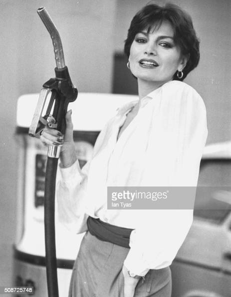 Turkish singer Ajda Pekkan soon appearing at the Eurovision Song Contest pictured pumping gas at a petrol station on Park Lane London March 17th 1980