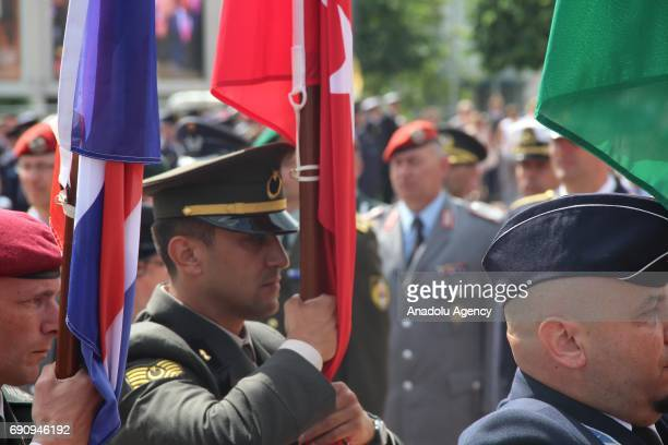 Turkish soldier carries a Turkish flag during the 50th Foundation Anniversary of the North Atlantic Treaty Organization Base in Brunssum Netherlands...