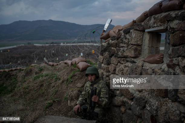 Turkish soldier from the 1st Border Regiment Command waits for instructions during an alert drill scenario at a military outpost on the Turkey/Syria...