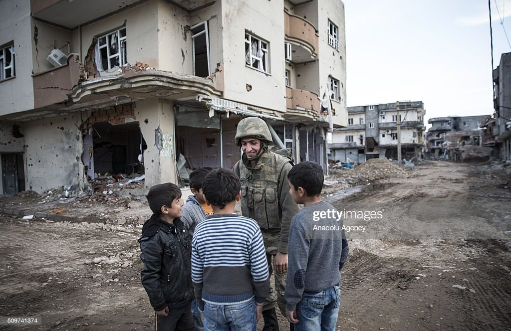 A Turkish soldier gives candies to children as Turkish security forces patrol around after counter-terror operation in Cizre, the southeastern Turkish town that has seen fighting rage between security forces and PKK terrorists finished, on February 12, 2016.
