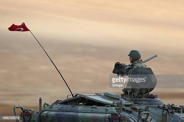 A Turkish soldier guards on the Syrian borderline in the southeastern town of Suruc on September 27 2014 in Sanliurfa province of Turkey Nearly...