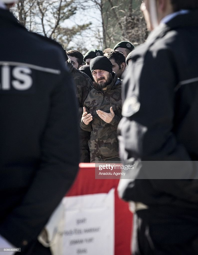 A Turkish soldier is seen near the coffins of Special operation police officer Osman Yurt, Police officer Mehmet Gungordu, Infantry Vedat Dolancay and Arif Subasioglu, who were martyred during an anti terror operation against PKK in Sirnak's Cizre, during a funeral ceremony at the 23. Border Division commandership of Gendarme forces in Sirnak, Turkey on February 10, 2016.