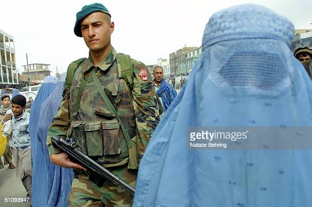 Turkish Soldier On Patrol In Central Kabul Walks April 30 2002 Amongst BurqaClad Women The Turkish Government Said Monday It Has Officially Agreed To...