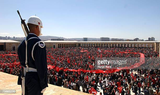 Turkish soldier stands guard during a rally against Turkish Prime Minister Tayyip Erdogan's possible candidacy to the presidency on April 14 in...