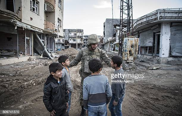 Turkish soldier talks to children as Turkish security forces patrol around after counterterror operation in Cizre the southeastern Turkish town that...