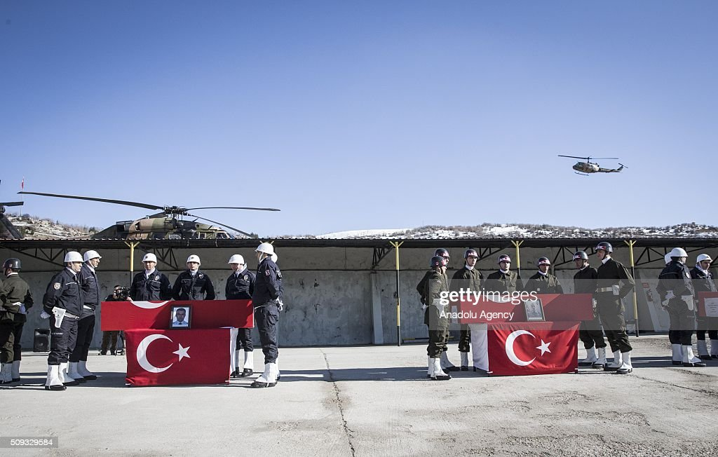 Turkish soldiers and police officers stand in silence near the coffins of Special operation police officer Osman Yurt, Police officer Mehmet Gungordu, Infantry Vedat Dolancay and Arif Subasioglu, who were martyred during an anti terror operation against PKK in Sirnak's Cizre, during a funeral ceremony at the 23. Border Division commandership of Gendarme forces in Sirnak, Turkey on February 10, 2016.