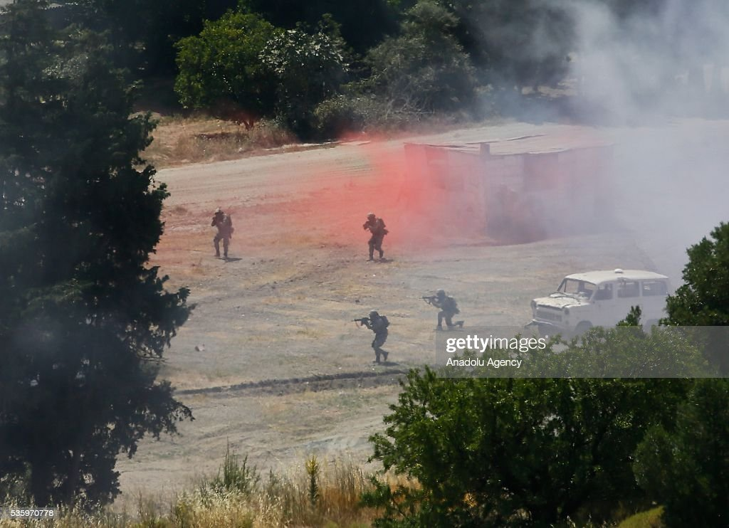 Turkish soldiers are in action during the Efes-2016 Combined Joint Live Fire Exercise at Seferihisar district of Izmir, Turkey on May 31, 2016. The Turkish-led multinational military exercises, Efes-2016 which started at 04 May and will be finished at 04 June 2016, aims to train participating units and staff in planning and conducting combined and joint operations, including logistics and command-control as well as to improve the level of interoperability among headquarters and forces.