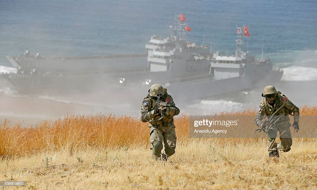 Turkish soldiers are seen during the Efes-2016 Combined Joint Live Fire Exercise at Seferihisar district of Izmir, Turkey on May 31, 2016. The Turkish-led multinational military exercises, Efes-2016 which started at 04 May and will be finished at 04 June 2016, aims to train participating units and staff in planning and conducting combined and joint operations, including logistics and command-control as well as to improve the level of interoperability among headquarters and forces.
