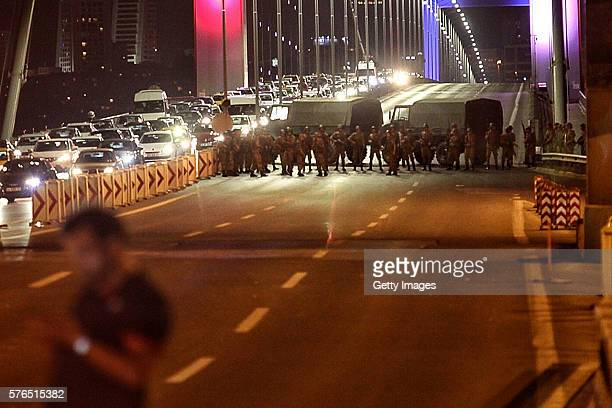 Turkish soldiers block Istanbul's Bosphorus Bridge on July 15 2016 in Istanbul Turkey Istanbul's bridges across the Bosphorus the strait separating...