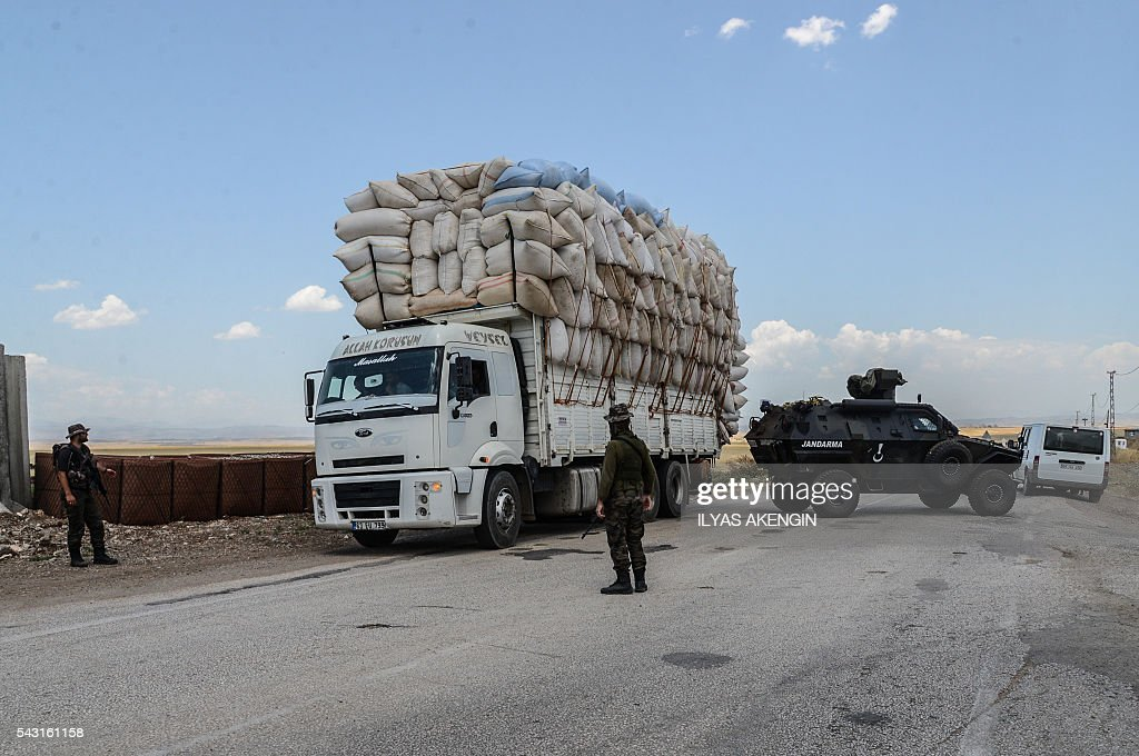 Turkish soldiers check a truck at a military check point as Members of Parliament of the pro-Kurdish Peoples' Democratic Party (HDP) and kurdish activists wait in a military check point as they want to enter Lice district in Diyarbakir on June 26, 2016. Militants from the outlawed Kurdistan Workers Party (PKK) on June 24, 2016 killed six Turkish soldiers in two separate attacks in the troubled southeast of the country, the army said. / AFP / ILYAS