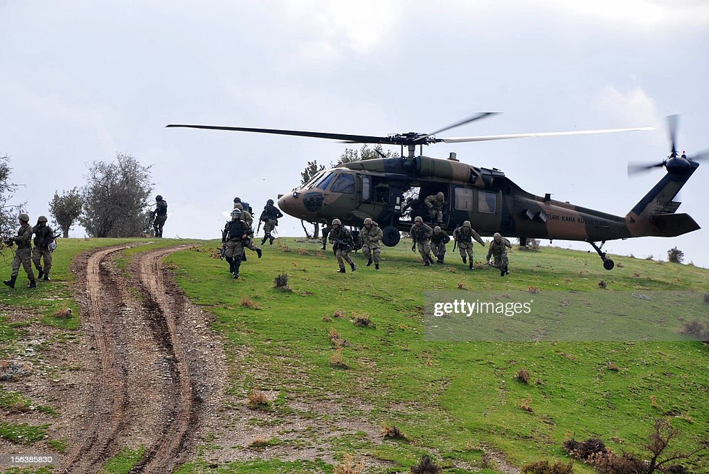 Turkish soldiers descend from a helicopter following clashes with the PKK (Kurdistan Workers Party) near Sirnak on November 14, 2012. Turkey's government submitted a bill to parliament yesterday to give Kurds the right to use their own language in court, a key demand of hundreds of prisoners who have been on hunger strike for two months.