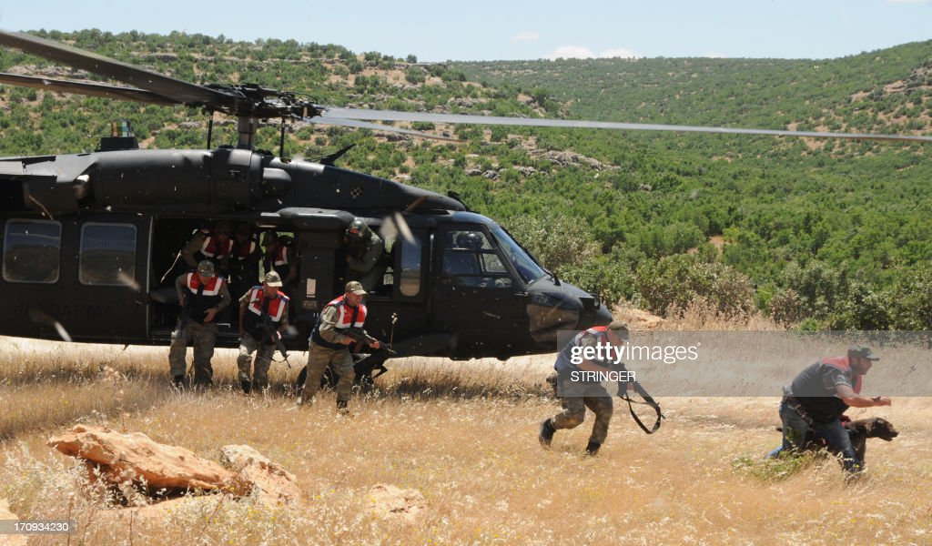 Turkish soldiers disembark from a helicopter during an operation to collect and burn marijuana plants at Lice in Diyarbakir on June 20, 2013. AFP PHOTO / STRINGER