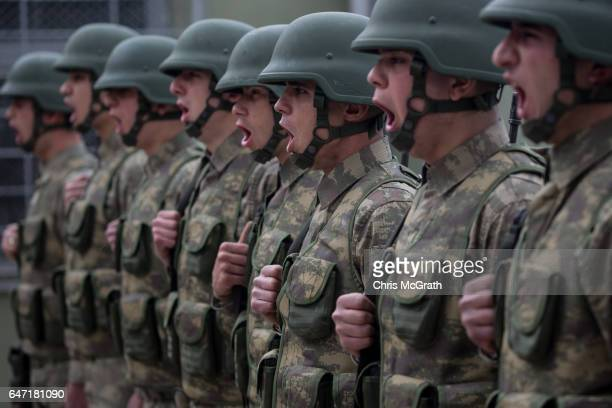Turkish soldiers from the 1st Border Regiment Command run through alert drills at a military outpost on the Turkey/Syria border on March 2 2017 in...