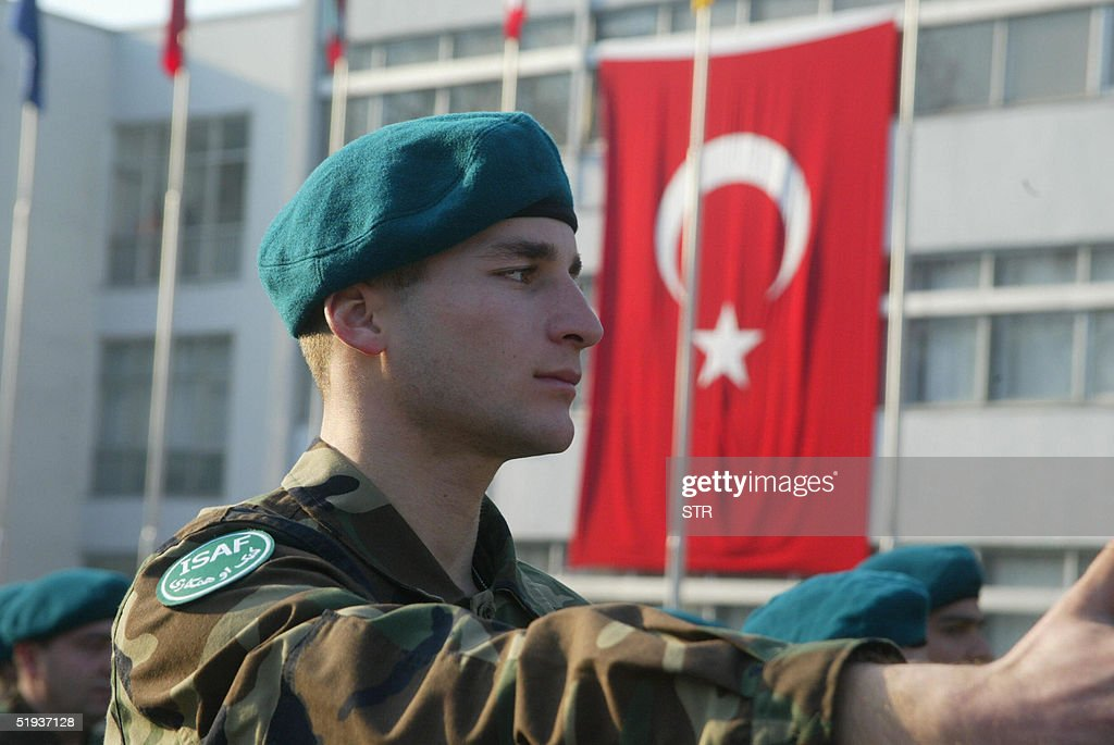 Turkish soldiers from the 3rd Corps parade in front of the Turkish Flag at the ISAF VII Misssion Farewell Ceremony at Ayazaga Barracks in Istanbul 11...