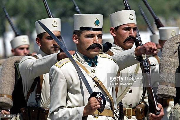 Turkish soldiers parading here in the uniforms of the former Ottoman army 30 August 2003 may be on their way back to old colonial stamping grounds in...