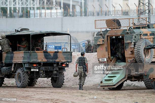 Turkish soldiers patrol near the Akcakale border gate in Sanliurfa province Turkey June 16 2015 Kurdish fighters took full control on Tuesday of the...