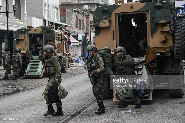 Turkish soldiers prepare themselves for military action during a curfew on February 26 2016 at Diyarbakir's historical Sur district eastern Turkey...